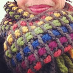 Just a photo, no link. But easy to do with alternate rows of rainbow and gray in Tunisian simple stitch.