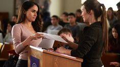 Rachel (Meghan Markle) approaches a classmate in season 6, episode 3 of Suits.
