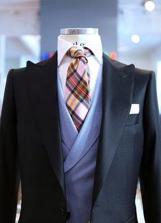 Plaid Tie by Lander Urquijo.  Very sleek cut and clean fit.