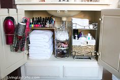 Take advantage of your under-the-sink storage space by using bins and over-the-cabinet hanging baskets.