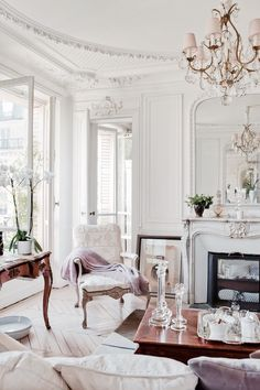 The natural light flooding this apartment is spot on. Along with the intricate ceiling details, ornate furniture and stunning chandeliers. And that Herringbone Floor! Parisien Chic, French Interiors. Photo credit: CoolChicStyleFashion