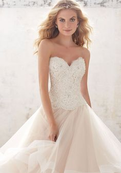 2017 Wedding Dresses and Bridal Gowns by Morilee designed by Madeline Gardner. This Ruffled Ballgown with Crystals and Lace Bodiceis perfect for your big day.