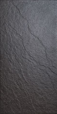 Magma Black Stone Effect Plain Porcelain Wall & Floor Tile, Pack of 6, (L)600mm (W)300mm £11 per M2