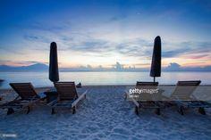 Sunrise scene of Sanur Beach Bali, Indonesia. Features a relaxed coastal ambiance.
