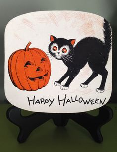 Vintage Halloween 1950s Candy Box Black Cat with Jack O Lantern Mid Century Halloween Decor Display Trick Or Treat Container by santashauntedboot on Etsy https://www.etsy.com/listing/241567665/vintage-halloween-1950s-candy-box-black