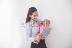 working computers: A portrait of busy businesswoman doing her job while carrying her newborn baby
