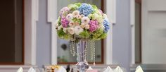 Tall wedding centerpieces are one of the brilliant ideas how to decorate your reception. Stunning coral, white, purple colors will make your wedding great!
