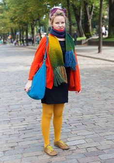 """Silja, 23    """"I'm wearing a scarf from Tallinn, a Cos cardigan, a dress from St Petersburg and Camper shoes.    I like colours, especially green, yellow and orange. My style is bold but always considered. I avoid shopping high street brands. I take style advice from my mother only.""""  22 September 2012, Esplanadi"""