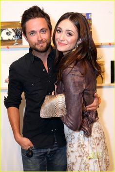 Emmy Rossum at Incognito Art Exhibition in 2011 wearing Lela Rose dress for Ann Taylor Loft ($98) w/ rugged leather jacket by Muubaa biker jacket, $530; revolveclothing.com) Transitions nicely from summer to fall; we can see it w/ jeans and a bright cashmere sweater when the weather gets cooler.