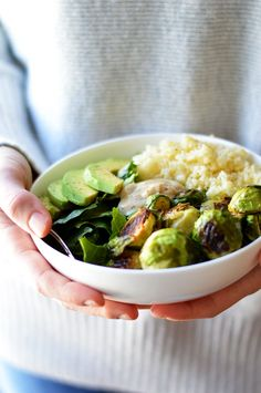 Packed with dark leafy greens, crispy roasted brussels sprouts, fluffy couscous, creamy avocado and a super simple vinaigrette -- this Roasted Brussels Sprout & Couscous Salad is nutrient-dense, filling and delicious. Healthy Dinner Recipes, Vegetarian Recipes, Cooking Recipes, Aioli, Couscous Salad Recipes, Vegan Clean, Healthy Eating, Healthy Food, Clean Eating