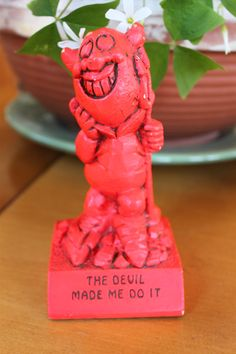 This has to be one of the hard to find rare statues. This statue is a figure of a red devil, it has a few scuff marks around the face area but Im sure can be fixed with a red marker. It stands 6 inches tall and it says: THE DEVIL MADE ME DO IT On the back it has PAULA 1971 W-214 Made in USA This is a rare collectible and a good find. In good vintage condition.