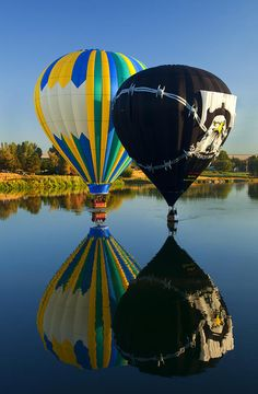 River Dance- A pair of Hot air balloons dance across the Yakima River near Prosser, dipping their baskets in the River.