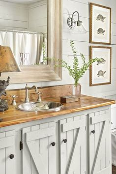 """For a cohesive (read: less choppy) look in the bathroom, the gray-green cabinetry (Prairie Grass by Sherwin-Williams) mimics the lower portion of the room's board-and-batten walls. """"Z-back"""" detailing adds rustic interest."""