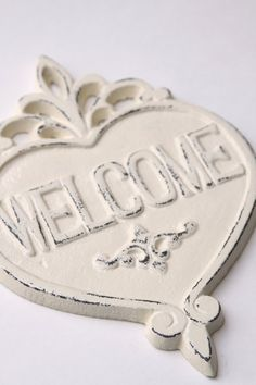 Give your friends and neighbors a heartfelt welcome with this cast iron sign. $16 from FourRDesigns on Etsy.