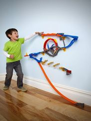 Hot Wheels Track Starter Set. Now, the tracks can be hung on the wall, behind a room door, on a closet door. The combinations are numerous, and the tracks can even go around corners. But Mom shouldn't be worried about the tracks leaving a mark. They are attached using 3M command strips and they come down without a trace. $30