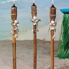 Considering every detail is key for a destination wedding, and the shell adornment on these tiki torches which can line toilet walkways, or aisles, really transform them into something unusual and unique.