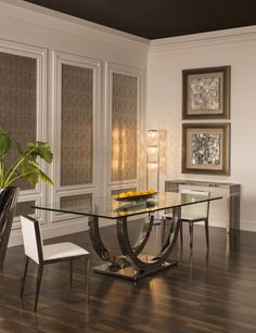 With a clean-lined design that focuses on contemporary style, the Ulysis Rectangular Dining Table is a modern masterpiece for your dining room. Flat polished edge glass graces its top, while stainless steel seals the look. The table's attention to the finest of details results in a highly sophisticated piece that can be used for daily dining or a slightly more formal occasion.