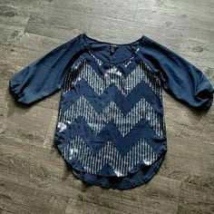 Rue 21 blouse Navy blue 100% polyester with sequined chevron print. Sheer effect. Slight high-low. Great with white or Jean shorts. Rue 21 Tops Blouses