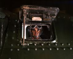 June 1942. Army tank driver at Fort Knox, Kentucky. 4×5 Kodachrome transparency by Alfred Palmer for the Office of War Information.
