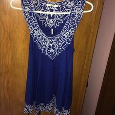 Blue tunic Great for summer! Adorable with leggings! You could probably wear this as a dress if you're pretty short. I'm 5'5 and it goes to my mid-thigh. Also has a tie in the back so it's more flattering to your waist. Never worn no stains or rips. Tops Tunics