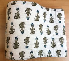 This lightweight cotton voile reversible bedding has been hand block printed and hand quilted.