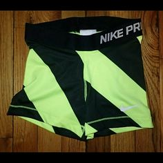 Nike Pro Striped Black/Neon Green Shorts XS - NWT  Brand new, never worn, no damage.    Smoke-free, pet-free household.    No trades/swaps!   No holds!   No low-balling!   No PayPal!   ✔ Reasonable offers welcomed! Please use the offer button so I know you are serious about the item! I will not respond to price negotiations via comments.  ✔ I love bundling! Not only will you get ONE shipping fee, I will also discount your combined total! Please ask me in the comments!   Happy poshing!  Nike…