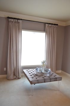 These soft pink custom silk drapes create a soothing effect in this space.