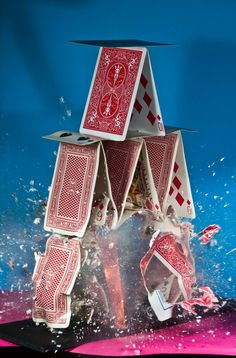 High speed photo of a stack of cards exploding
