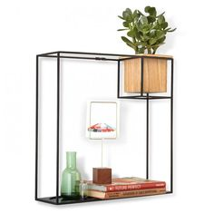 Display your favorite items on this minimalist shelf and wall planter. A multifunctional cup holds succulents and flowers, and a removable shelf makes it easy to accommodate different orientations. Inspired by Piet Mondrian and his iconic compositions, this wall shelf brings function and design to every room of the house. Available in two sizes. <ul> <li>Welded square rod frame with removable tray that slides and inserts into frame</li> <li>Removable wooden cup a...