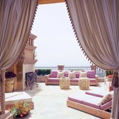 55 Awesome Morocco-Style Patio Designs : 55 Charming Morocco Style Patio Designs With Brown Curtain And Wooden Purple Sofa Chair Table Pillow Stone Floor And Fireplace With Skyline View