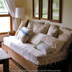 Build a rustic inspired couch with pillows and a twin mattress. #home #decor
