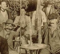 Close-up of the 1893 postcard,showing a group of country folk relaxing over their absinthes at the end of hard day's fishing. Note the absinthe fountain.