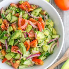 Ingredients  1 lb Roma tomatoes 1 English cucumber ½ medium red onion, sliced 2 avocados, diced 2 Tbsp extra virgin olive oil or sunflower oil Juice of 1 medium lemon (about 2 Tbsp) ¼ cup (1/2 bunch) cilantro, chopped 1 tsp sea salt or ¾ tsp table salt ⅛ tsp black pepper  Instructions  Place chopped tomatoes, sliced cucumber,