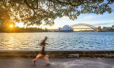 Australia, New South Wales, NSW, Sydney, Sydney Opera House, Sydney Harbour Bridge, Oceania, People running at sunset with Opera House and the Harbour Bridge in the background