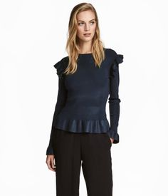 Dark blue. Fitted sweater in soft, fine-knit viscose-blend fabric with a slight sheen. Knit flounces on shoulders and at cuffs and hem.