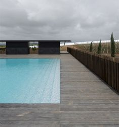 A set of gabled concrete blocks have been added to a hotel on a vineyard in rural Portugal by João Mendes Ribeiro Concrete Building, Concrete Blocks, Kitchen Garden Plants, Wine Hotel, Hotel Portugal, Aqua Pools, Paint Photography, Concrete Structure, Garden Pool