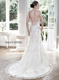 Vintage inspired A-line wedding dress with plunging neckline and deep illusion scoop back, Carlynne by Maggie Sottero.