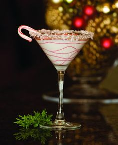 Candy Cane Martini ~ Stoli Vanil Vodka Godiva White Chocolate Liquer Peppermint Schnapps White chocolate colored with red food coloring Small Candy Canes