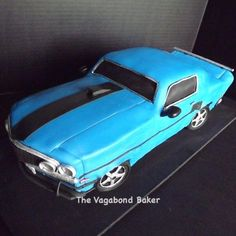 My first car cake! A blue '69 Ford Mustang! This was a little stressful! A know that car guys are really serious about their cars. The bride ordered it for a surprise for the groom, and I was really happy when I saw how excited he was when he saw it!