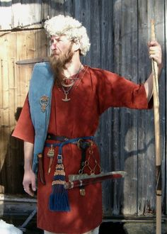 A Finnish Iron Age man with tablet woven belt, plus bronze spiral decorations