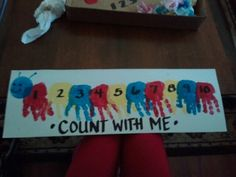 "Made this ""Count With Me Centipede"" with Mason today. I'm sure this has been done before hundreds of times but I came up with it on my own. I took a poster board and cut it down the middle, turned it horizontally, painted Mason's hand (all except for his thumb) and had him ""high-five"" the paper. (That's how I get him to open his hand up.) Then I flipped the paper so the fingers point downwards, painted the centipede's head, and when it was dry I did the details with a Sharpie marker. :)"
