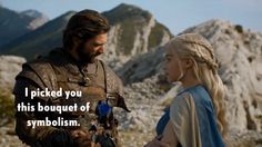 , Game of Thrones went all lit major one more time last season when Daario picked Dany this bouquet of flowers. The white flower is for our favorite platinum-haired Khaleesi. The blue flower is pretty consistently a symbol for Jon Snow in the books. (Rhaegar placed a crown of blue roses in Lyanna Stark's lap, and Daenerys dreams of a blue flower growing out of the Wall.) The red and gold flower stands for the colors of house Lannister a.k.a. Tyrion.