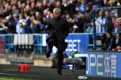 Jose Mourinho Manager of Manchester United controls the ball during the Premier League match between Huddersfield Town and Manchester United at John...