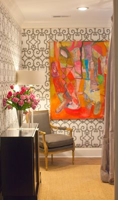 Colorful large-scale art paired with trellis wallpaper