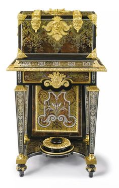 A LOUIS XIV ORMOLU-MOUNTED TORTOISESHELL, TINTED HORN, BRASS AND PEWTER-INLAID BOULLE MARQUETRY AND EBONY COFFER ON STAND, Attributed to André-Charles Boulle circa 1710.