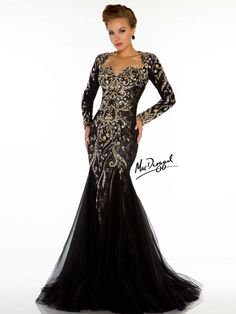 Who would be able to look away when your wear this amazing dress by Mac Duggal Couture 81898D formal gown. The whole bodice is completely beaded embellished over lace and the bust line compliment the long sleeved gown. The back adorns a keyhole back and the form fitted mermaid train is layers and layer of tulle.