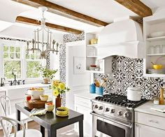 white bright kitchen ceiling beams feature wall pattern