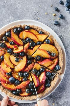 Fresh Peach and Blueberry Tart with Walnut Crust: Refined sugar free, vegan, and ready in under an hour and a half. A healthier alternative to the buttery summer fruit tart we all love.