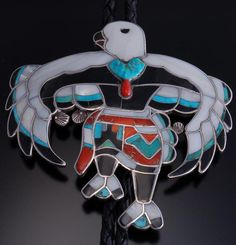 It is made by Dixon Shebola, a Zuni artist who made mosaic inlay ceremonial jewelry in the 1960's-1970's. A similar bolo tie is featured in Toshio Sei's bookKachinas and Cermonial Dancers in Zuni Jewelry. | eBay!