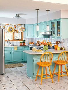 This kitchen is not afraid of color! Try pairing complementary colors together for a bold, fun look!